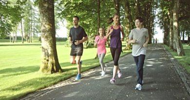 stock-video-80865849-slo-mo-ts-family-jogging-through-park-on-sunny-day