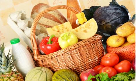 Groceries in wicker basket on kitchen table